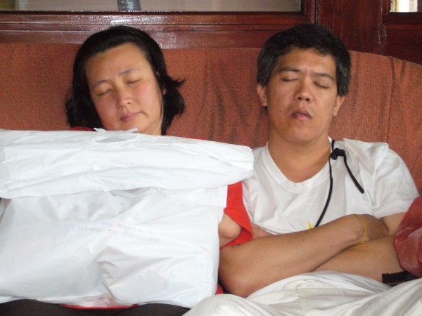 Stanley & ST catching some sleep while waiting for the evening bus back to Lao Cai train station