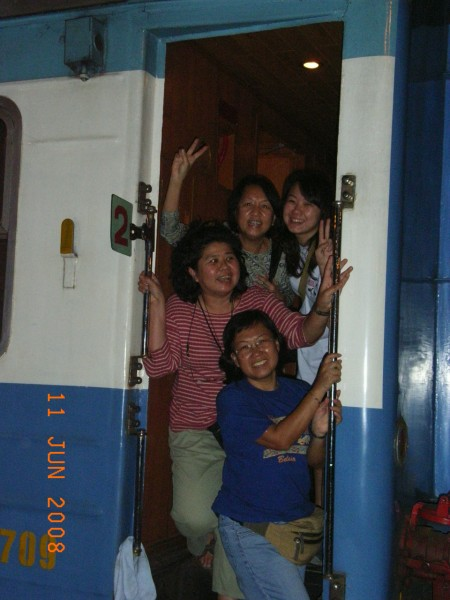posing at the entrance/exit of our coach.